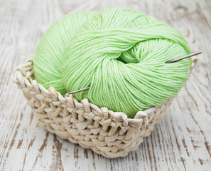 .Green yarns and crotchet hook