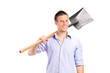 Young man holding a shovel