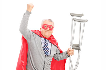 Superhero with crutches gesturing happiness