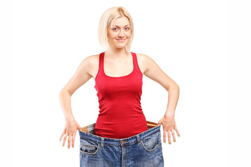 Woman standing in a pair of oversized jeans