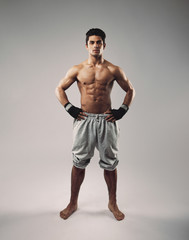 Shirtless muscular man posing in sweatpants