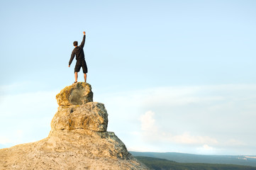 Man on top of mountain.