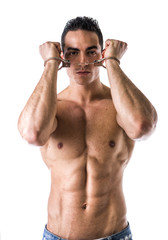 Muscular shirtless young man with handcuffs