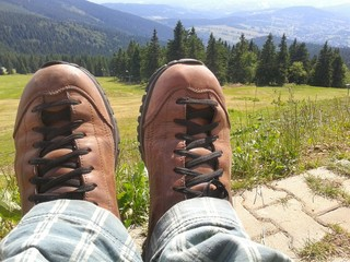 Tourist boots with mountain view