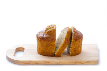 Banana cake on chopping board. Isolated