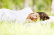 canvas print picture - Woman sleeping on grass
