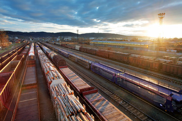 Railway at sunset with cargo trains.