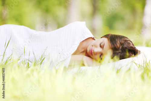 canvas print picture Woman sleeping on grass
