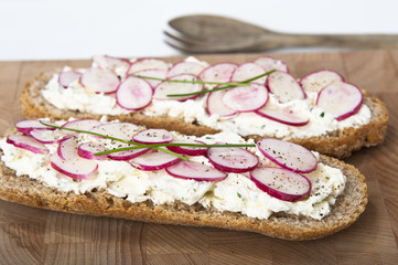 bread with cream robiola cheese and radishes