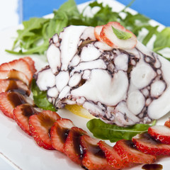 octopus carpaccio with rucola salad and strawberries