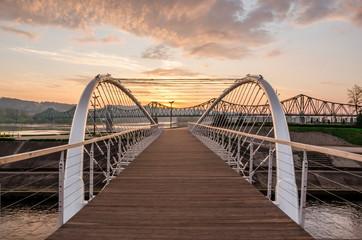 Footbridge on Zglowiaczka in Wloclawek at sunrise