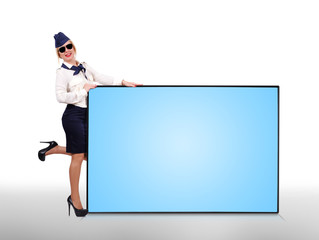 Flight attendant holding big panel