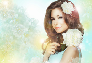 Quiet Romantic Woman with Flowers over Colored Bokeh Background