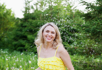 Happy smiling woman outdoors in summer