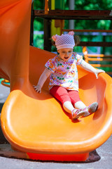 Small girl having fun on a slide