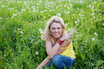 Happy smiling woman outdoors in summer with blawballs
