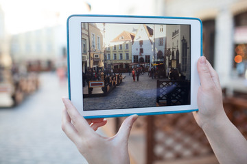 Making photo or video with pad of old street in Tallinn, Estonia
