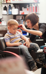 Little boy at the hairdresser