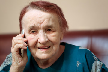 Elderly lady talking on a mobile phone