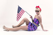 Pin up girl holding USA flag. Vintage style.