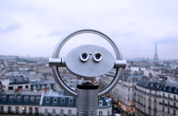 Binocular with Eiffel Tower on the background