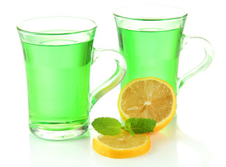 Two transparent cups of green tea and lemon isolated on white