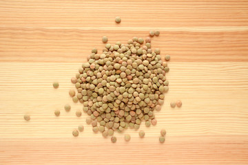 Green lentils on wood