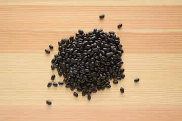 Black turtle beans on wood