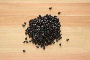 Black turtle beans on wood