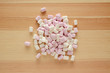 Pink and white mini marshmallows on wood