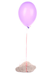 Color balloon with stone isolated on white