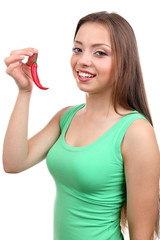 Beautiful girl with chili pepper, isolated on white
