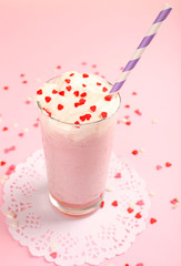 Delicious milkshake on table