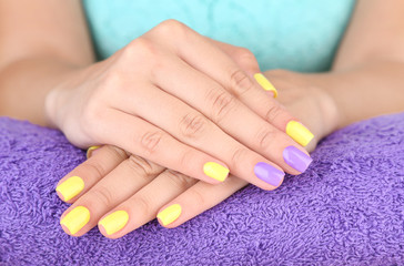 Female hand with stylish colorful nails,