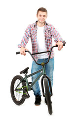 Young boy on BMX bike isolated on white