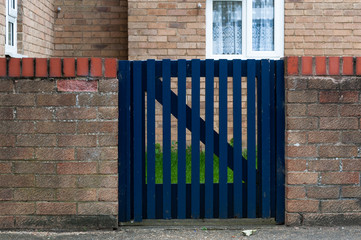 Blue wooden boundary wall door