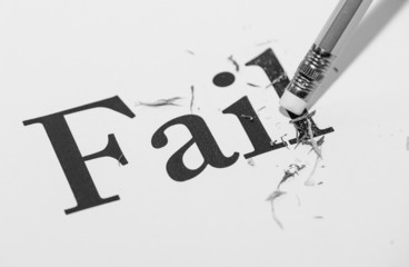 "pencil and the word ""fail"" on black and white color"