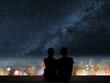 couple sit under strars