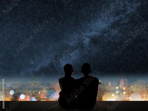 couple sit under strars - 66845848