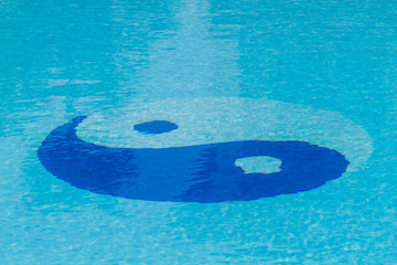 Yin Yang symbol in the pool.