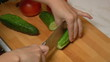 Green Cucumbers Cut into Slices for Cooking, closeup