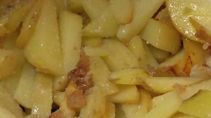 Frying Pan with Sliced Potatoes, macro
