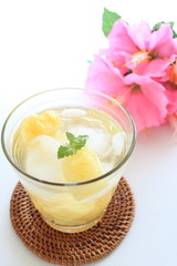 Pineapple sode with flower for tropical drink image