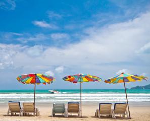 Beach chairs and colorful umbrella on the beach at Phuket Thaila