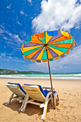 Beach chairs and colorful umbrella on the beach, Phuket Thailand
