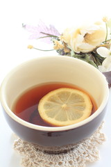 Lemon tea with flower on background