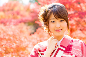 asian woman wearing japanese kimono in fall