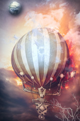 Hot air balloon in the sunset of fire