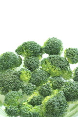 chopped broccoli in water for food preparation image