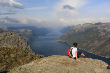 Hiking in mountains to Preikestolen (Pulpit Rock), Norway